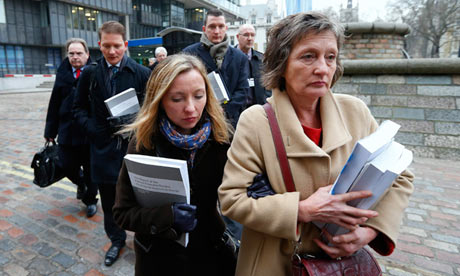 Geraldine Fimucane, Pat Fimucane's widow leads her family into court in Belfast to challenge David Cameron's refusal to hold the promised public inquiry into her husband's assassination