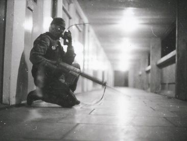 A soldier from the First Gloucesters uses a Stornophone type radio while on patrol in Divis Flats in April 1972 - copyright