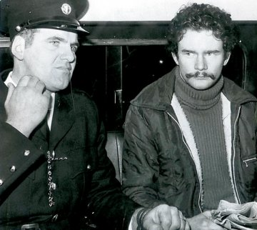 Wearing a moustache, Martin McGuinness in Garda custody prior to one of his court appearances in Dublin