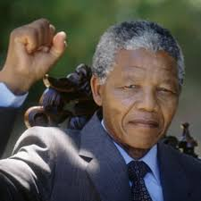 Mandela flourishes a revolutionary's fist
