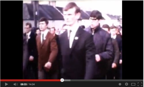 Is this Gerry Adams, wearing classes, on the right?