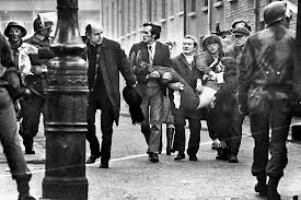 A victim of the Paras' violence on Bloody Sunday is carried away