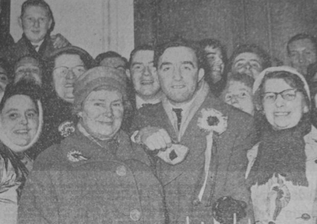 Boal celebrates his election to Stormont as the MP for Shankill. His constituency took in the Court Ward, which some regard as the birthplace of the Gusty Spence UVF. Boal's more radical stance on social and economic issues reflected the area's disregard for 'fur-coat Unionism', its traditional support for Independent Unionism and the subsequent development of the Progressive Unionist Party, the UVF's political wing which embodied many of these