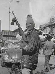 An IRA checkpoint in Derry, behind the barricades that made much of the city a no-go area fro British forces