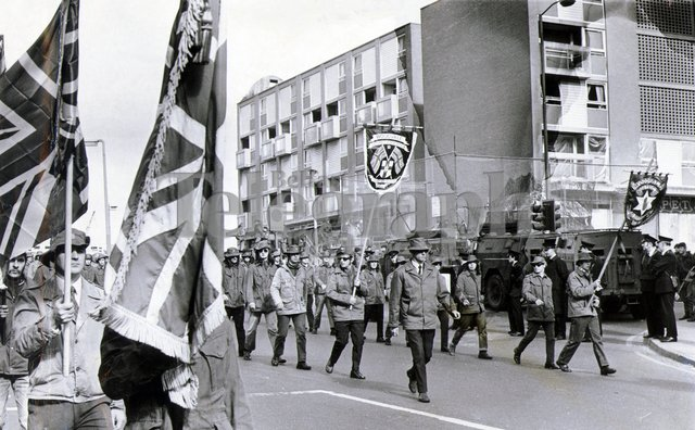 The UDA, at the height of their power in 1972, parade past the Nationalist Unity Flats