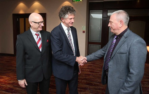 JOnathan Powell meets Jackie McDonald (UDA) on the right and Billy Hutchinson (PUP) on left.