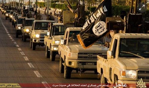 ISIS fighters parade through the town of the strategic town of Sirte