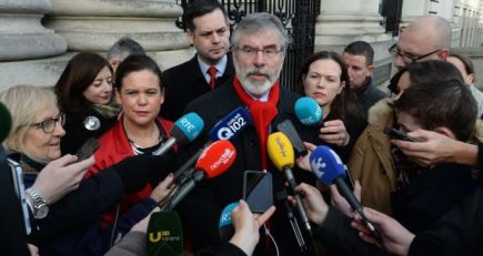Sinn Fein leader Gerry Adams with party members outside Government Buildings. Photograph: Dara Mac Donaill / The Irish Times