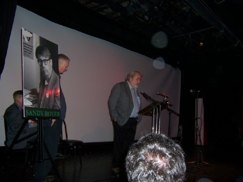 Mike Fleshman address the memorial ceremony at Theatre 80