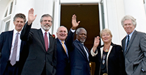 Jonathan Powell (far left) poses with Gerry Adams and other friends at an undisclosed venue