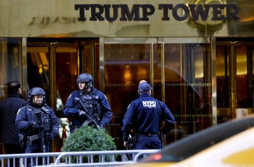Heavily armed New York cops stand guard outside Trump Tower in Manhattan. The new president
