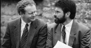 With Gerry Adams. He succeeded Adams as Chief of Staff when Adams was arrested and charged with IRA membership in the wake of the La Mon atrocity